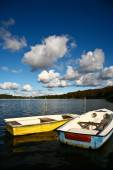 Colorful boats on a lake with cloudy blue sky in Denmark — Stock Photo