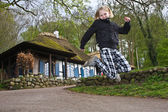 Girl jumping in the air — Stock Photo