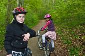 Girls riding on bikes — Stock Photo