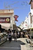 Walk through a pedestrian shopping street — Stock Photo