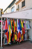 Shop at Saintes-Maries-de-la-Mer that sells flags — Stock fotografie