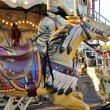 Carousel with wooden horses — Stock Photo #53453669