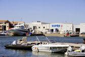 Small motor boat dock — Stock Photo