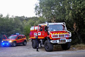 Fire trucks at the entrance of a forest road — Stock Photo