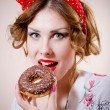 Closeup portrait of pinup girl beautiful blond young woman with excellent dental care teeth having fun eating donut happy smiling & looking at camera on white background — Stock Photo #52971935