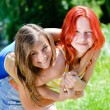 2 girls friends young pretty women happy smiling having fun hugging together & looking at camera on summer green park outdoors copy space background closeup portrait — Stock Photo #52986593