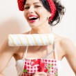 Closeup on pretty funny brunette sexy pinup girl holding paint bolster, having good time & fun looking at camera and laughing joyfully on white or light copy space background portrait picture — Stock Photo #53102741
