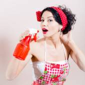 Closeup on glamor dehydration: gorgeous funny young brunette pinup lady having fun holding sprinkler and spraying in mouth looking at camera over white or light copy space background portrait picture — Stock Photo
