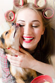 Woman hugging with little dog in her arms — Stock Photo