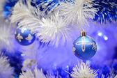 Christmas glass toys on faux pine tree — Stock Photo