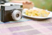 Piece of tasty biscuit apple pie and retro photo camera — Stock Photo