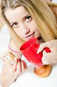 Woman  biting color glace donut — Stock Photo