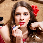 Sexual girl draws red lipstick open lips — Stock Photo