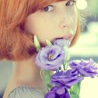 Young woman holding blue rose flowers — Stock Photo #54060593