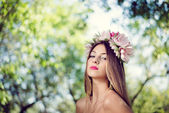 Pretty girl in lotus flower crown — Stock Photo