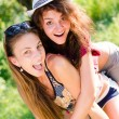 Young women having joyful time outdoors — Stock Photo #54089411