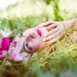 Woman lying gracefully on green grass — Stock Photo #54105419