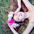 Woman lying gracefully on green grass — Stock Photo #54106267