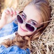 Blond girl relaxing on hay — Stock Photo #54108487