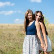Two girls in summer field — Stock Photo #54167985