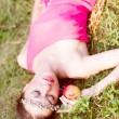 Young woman lying on green grass — Stock Photo #54216881