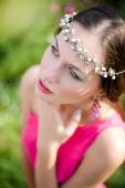 Woman wearing silver diadem looking up — Stock Photo