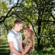 Young couple hugging in autumn orchard — Stock Photo #55304223