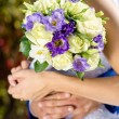Wedding roses bouquet in bride hands closeup — Stock Photo #56069183
