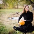 Girl with pumpkin — Stock Photo #58505365