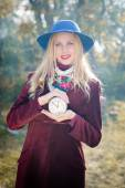Girl with retro clock — Stock Photo