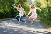 Two friends jumping — Stock Photo