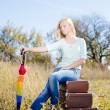 Girl sitting on retro suitcases — Stock Photo #58536163