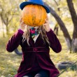 Portrait of holding pumpkin elegant beautiful blond young hipster woman having fun happy smiling and looking at camera on autumn copy space outdoors background — Stock Photo #58536195