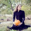 Woman holding pumpkin — Stock Photo #58536203