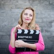 Woman holding cinema clapper board — Stock Photo #58536345