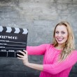 Woman holding clapper board — Stock Photo #58536361