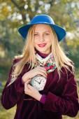 Girl with retro alarm clock — Stok fotoğraf