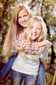 Girls embracing together — Foto Stock