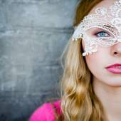 Young lady in lace mask — Stock Photo