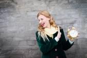 Teenage girl with clock — Stock Photo