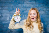 Girl with golden alarm clock — Stock Photo