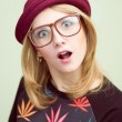 Studio portrait of teenage hipster girl wearing trendy eyeglasses and hat over olive copy space background — Stock Photo #60348685