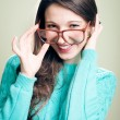 Girl in big glasses wearing knitting jumper — Stock Photo #62288535