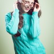 Girl in big glasses wearing knitting jumper — Stock Photo #62288547