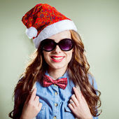 Girl in Christmas hat and glasses — Stock Photo