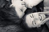 Girls lying head to head — Stock Photo