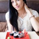 Woman eating sushi — Stock Photo #62850539