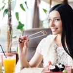 Woman eating sushi — Stock Photo #62850581