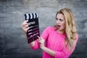 Woman with cinema clapper board — Stock Photo