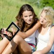 Girls having fun using tablet — Stock Photo #63155143